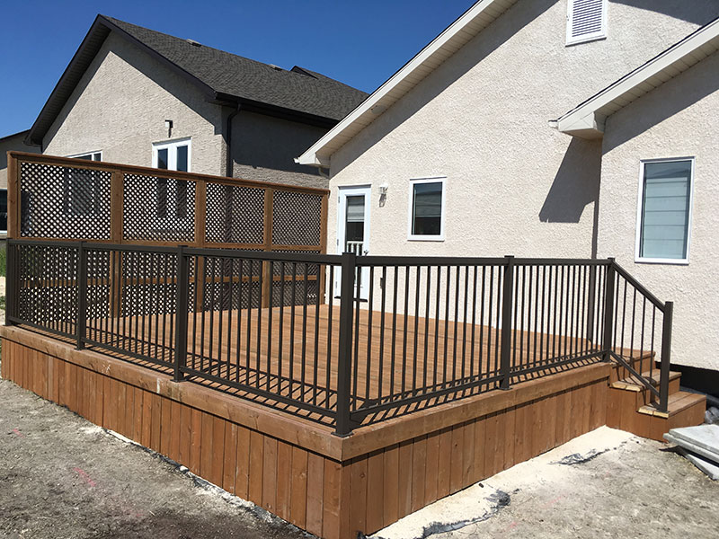 Wood deck with iron fence